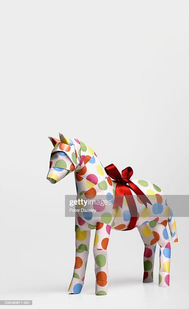 Gift horse with ribbon against white background, close-up : Stock Photo