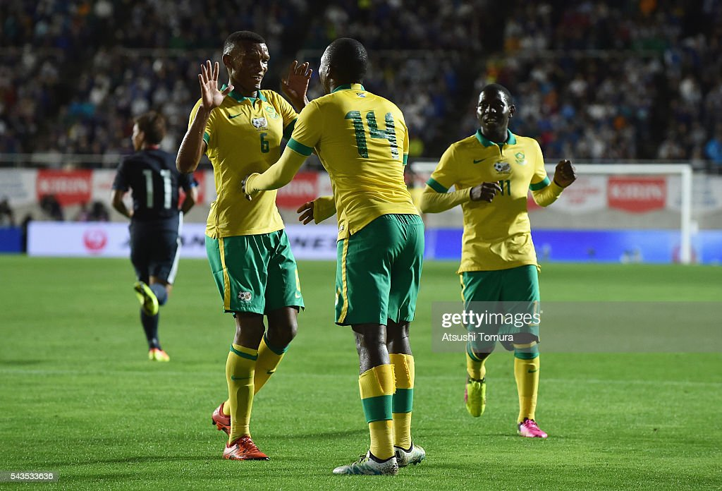 Gift Motupa (C) of South Africa celebrates scoring the opening goal with his team mates Mothiba Mvalo (L) and Maphosa Modiba (R) during the U-23 international friendly match between Japan and South Africa at the Matsumotodaira Football Stadium on June 29, 2016 in Matsumoto, Nagano, Japan.