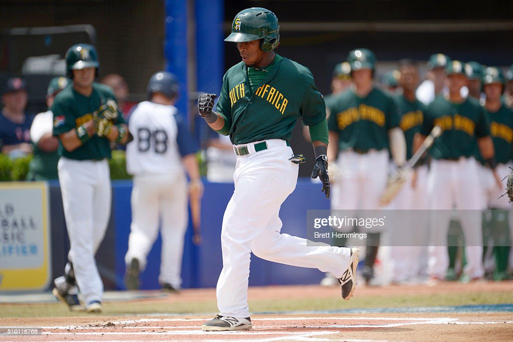 Gift Ngoepe of South Africa celebrates after hitting a home run during the World baseball Classic Final match between Australia and South Africa at Blacktown International Sportspark on February 14, 2016 in Sydney, Australia.