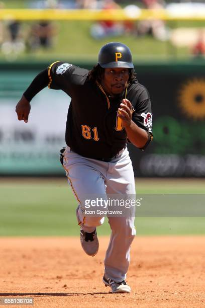 Gift Ngoepe of the Pirates hustles over to third base during the spring training game between the Pittsburgh Pirates and the Philadelphia Phillies on...