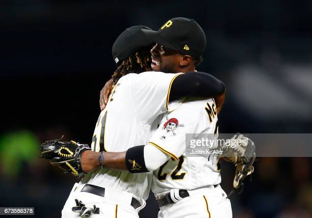 Gift Ngoepe of the Pittsburgh Pirates and Andrew McCutchen hug after defeating the Chicago Cubs 65 at PNC Park on April 26 2017 in Pittsburgh...