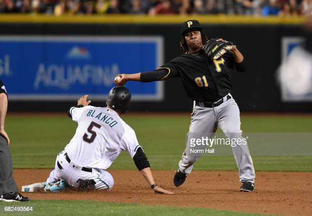 Gift Ngoepe of the Pittsburgh Pirates attempts to turn a double play as Gregor Blanco of the Arizona Diamondbacks slides into second base during the...
