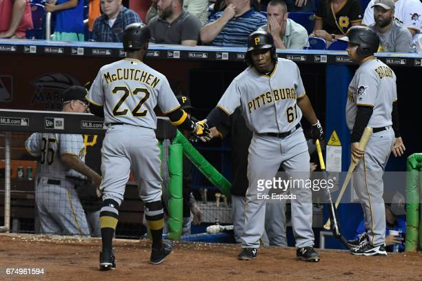 Gift Ngoepe of the Pittsburgh Pirates congratulates Andrew McCutchen after scoring in the 6th inning against the Miami Marlins at Marlins Park on...