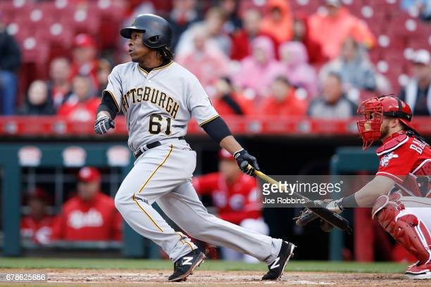 Gift Ngoepe of the Pittsburgh Pirates doubles to center field to drive in a run in the second inning of a game against the Cincinnati Reds at Great...