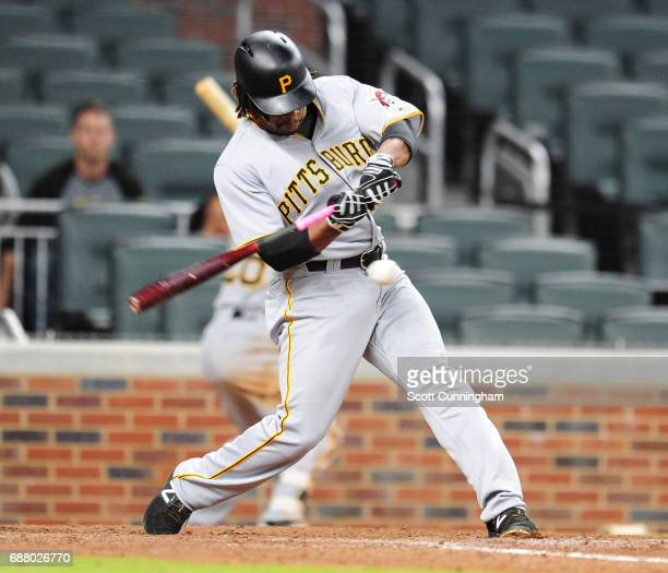 Gift Ngoepe of the Pittsburgh Pirates hits a tenth inning double to score a run to take the lead against the Atlanta Braves at SunTrust Park on May...