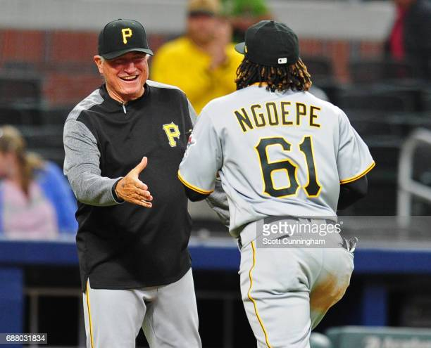 Gift Ngoepe of the Pittsburgh Pirates is congratulated by manager Clint Hurdle after the game against the Atlanta Braves at SunTrust Park on May 24...