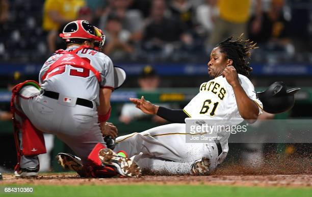 Gift Ngoepe of the Pittsburgh Pirates is tagged out by Jose Lobaton of the Washington Nationals during the eighth inning at PNC Park on May 17 2017...