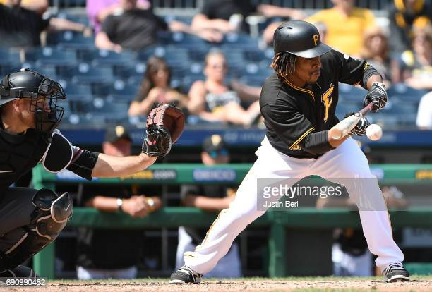 Gift Ngoepe of the Pittsburgh Pirates lays down a sacrifice bunt in the ninth inning during the game against the Arizona Diamondbacks at PNC Park on...