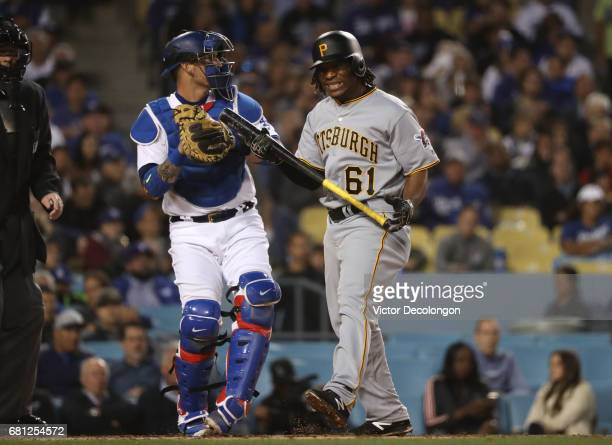 Gift Ngoepe of the Pittsburgh Pirates reacts after striking in the third inning as catcher Yasmani Grandal of the Los Angeles Dodgers looks to throw...