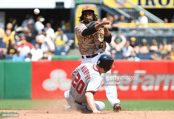 Gift Ngoepe of the Pittsburgh Pirates starts a double play against Daniel Murphy of the Washington Nationals in the sixth inning during the game at...