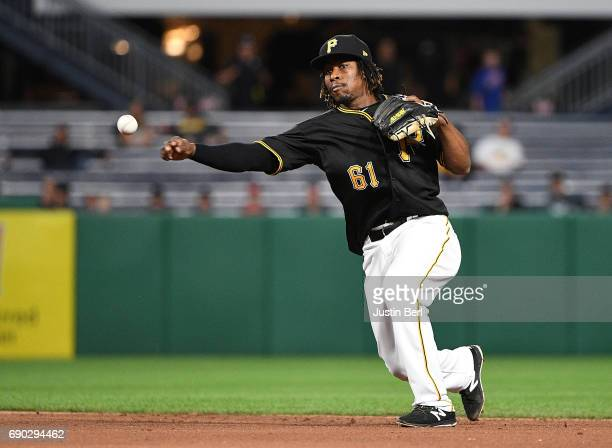 Gift Ngoepe of the Pittsburgh Pirates throws to first base for a force out of Reymond Fuentes of the Arizona Diamondbacks in the seventh inning...