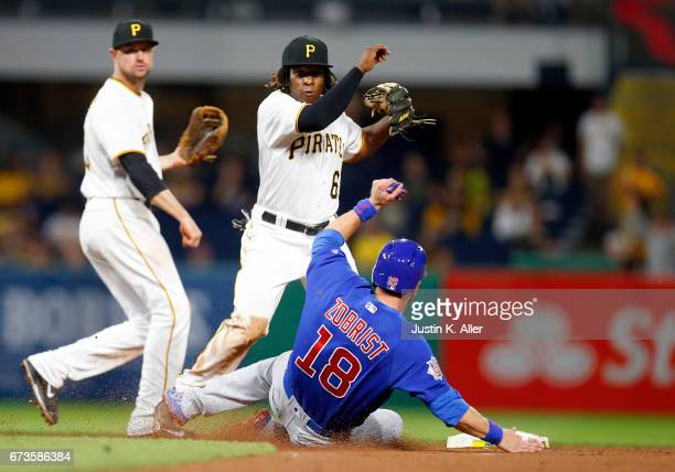 Gift Ngoepe of the Pittsburgh Pirates turns the game ending double play against Ben Zobrist of the Chicago Cubs in the ninth inning at PNC Park on...