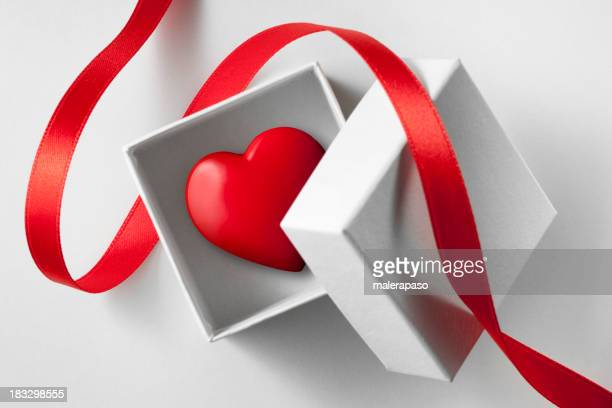 Gift of love. Small box with heart.