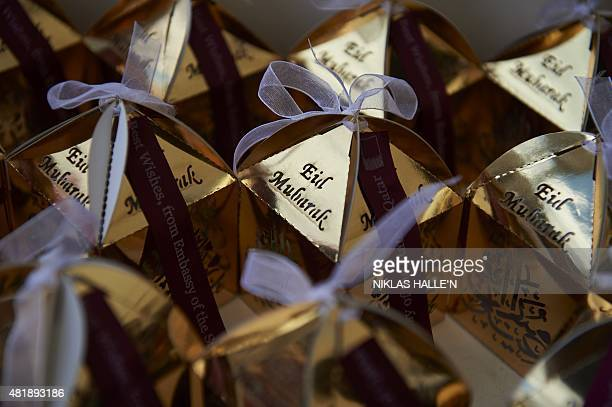 Gift packages are on display during Eid festival celebrations in London's Trafalgar square marking the end of the muslim holy month of Ramadan on...