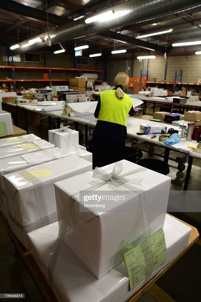 Gift registry items sit boxed and wrapped at the Myer Holdings Ltd. distribution center in Melbourne, Australia, on Tuesday, Sept. 3, 2013. A Bureau of Statistics report released in Sydney on Sept. 4 showed household spending climbed 0.4 percent in the second quarter, adding 0.2 percentage point to gross domestic product growth. Photographer: Carla Gottgens/Bloomberg via Getty Images