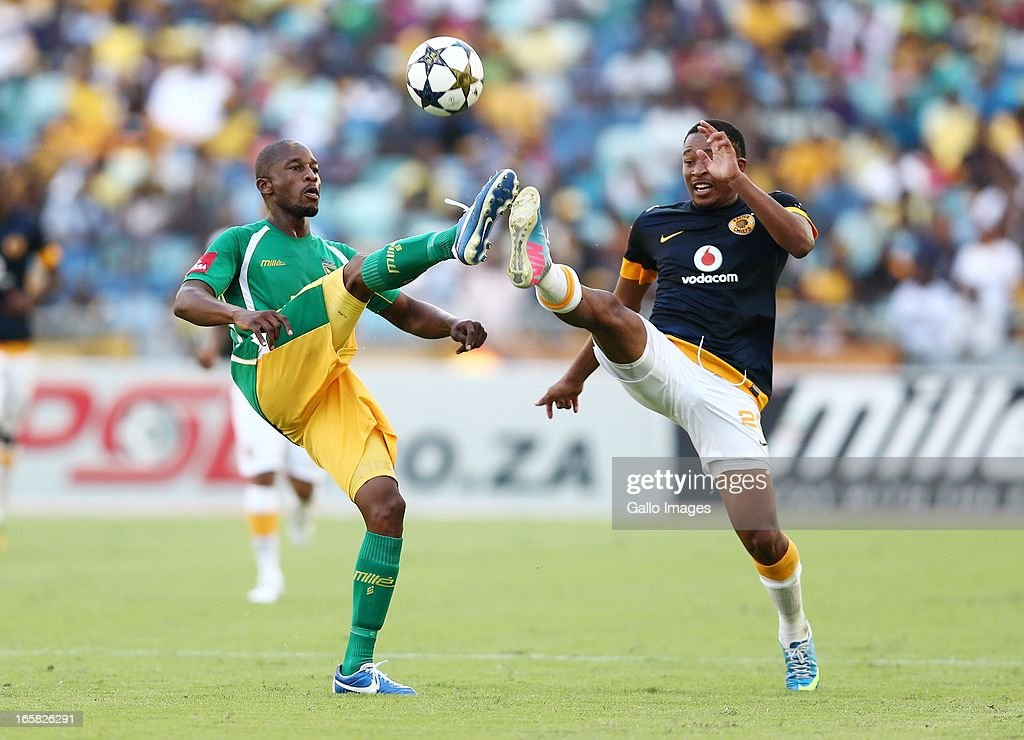 Gift Sithole (L) battles with Lehlohonolo Majoro during the Absa Premiership match between Golden Arrows and Kaizer Chiefs at Moses Mabhida Stadium on April 06, 2013 in Durban, South Africa.