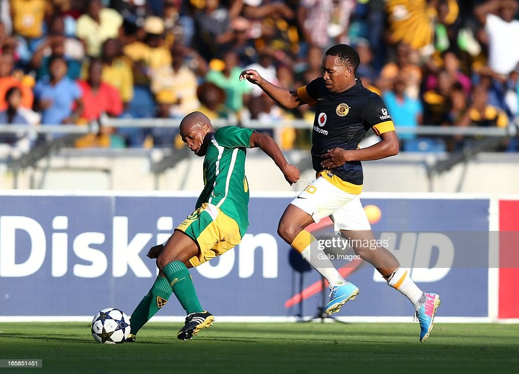 Gift Sithole holds off Lehlohonolo Majoro during the Absa Premiership match between Golden Arrows and Kaizer Chiefs at Moses Mabhida Stadium on April 06, 2013 in Durban, South Africa.