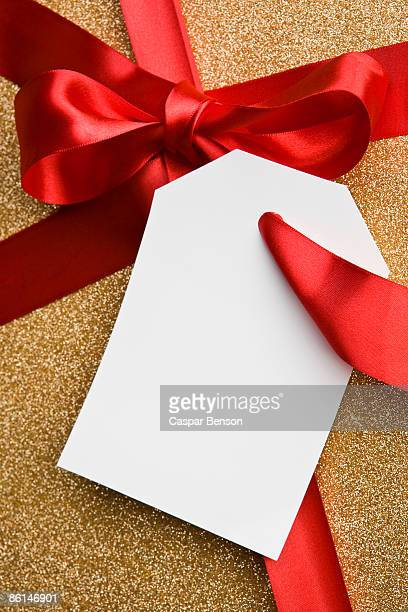 A gift tied with a red ribbon