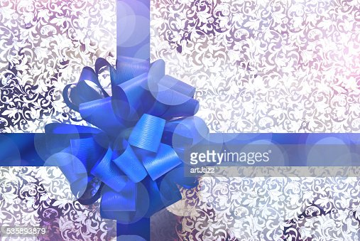 Gift with blue bow and ribbon : Stock Photo