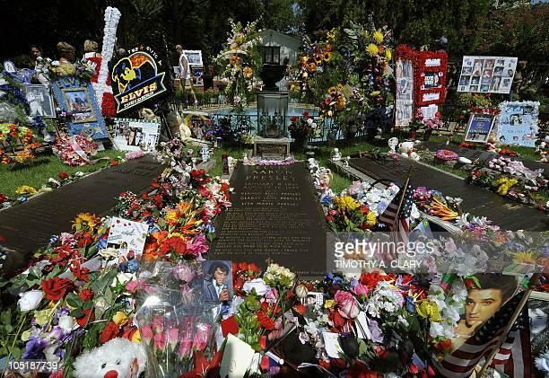Gifts left by thousands of Elvis Presley fans left on his grave August 16 2010 at Graceland Mansion his residence in Memphis Elvis died at Graceland...