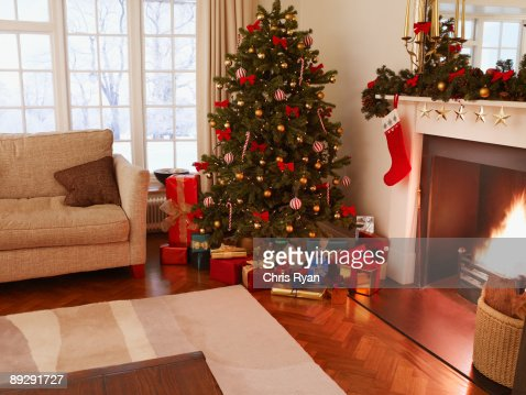 Gifts under christmas tree in living room stock photo getty images for Christmas tree in living room photos