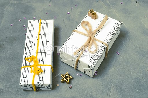 Gifts Wrapped In Paper With The Image Of Music Christmas Holiday ... ff9801b305