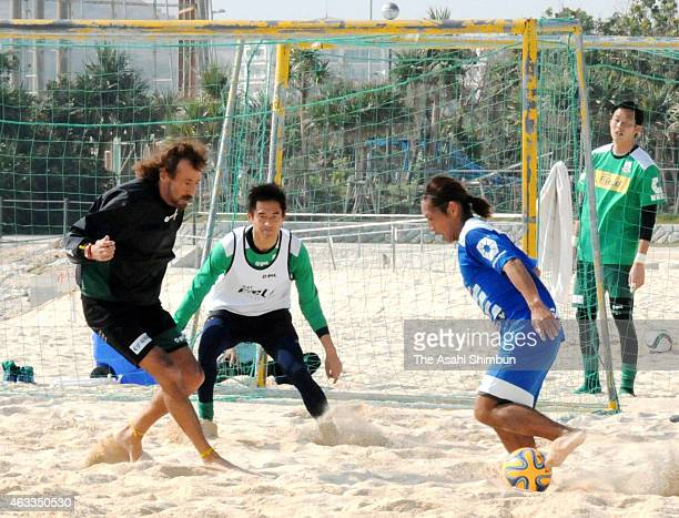 FC Gifu head coach Ramos Ruy and Yoshikatsu Kawaguchi in action during a beach soccer at the last day of their spring training camp on February 13...
