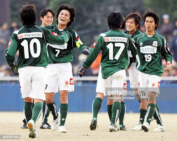 FC Gifu players celebrate their promotion to the JFL after winning the JFL/Regional League playoff against Honda Lock at the Nagaragawa Kyugi Meadow...