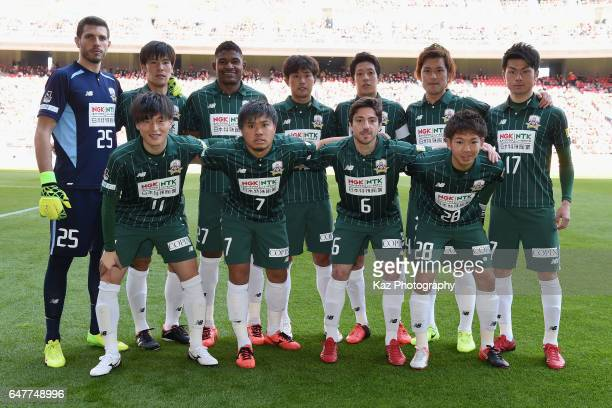Gifu players line up for team photos prior to the JLeague J2 match between Nagoya Grampus and FC Gifu at Toyota Stadium on March 4 2017 in Toyota...