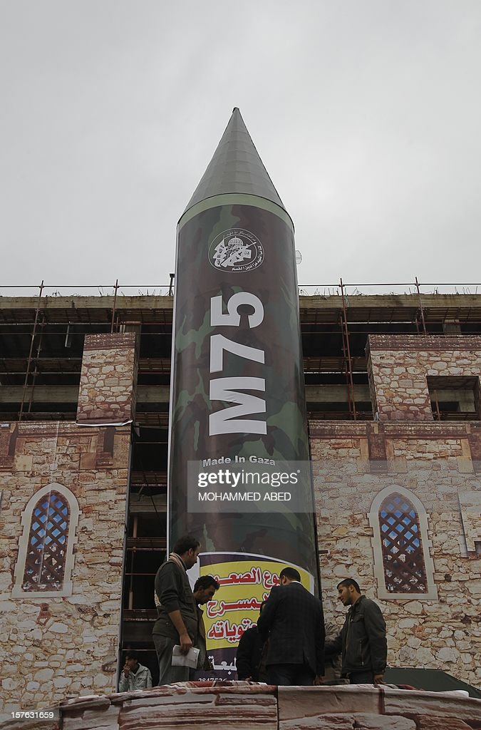 A gigantic model of a locally made M75 rocket is seen on stage during preparations for a Hamas rally in Gaza City on December 5, 2012. Hamas' armed wing said they had fired such a rocket towards Jerusalem and Tel Aviv during the eight day-long conflict between Israel and Hamas last month. AFP PHOTO/MOHAMMED ABED