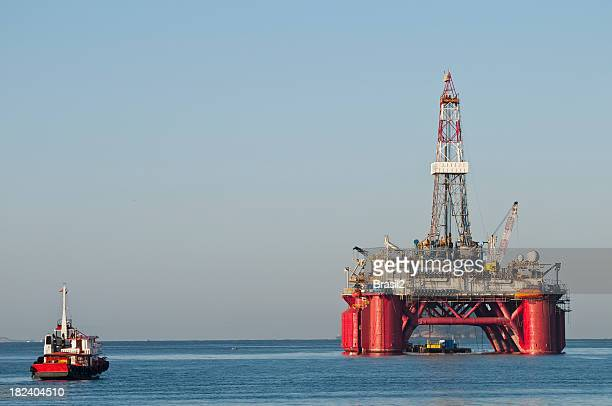 A gigantic oil rig platform and boat