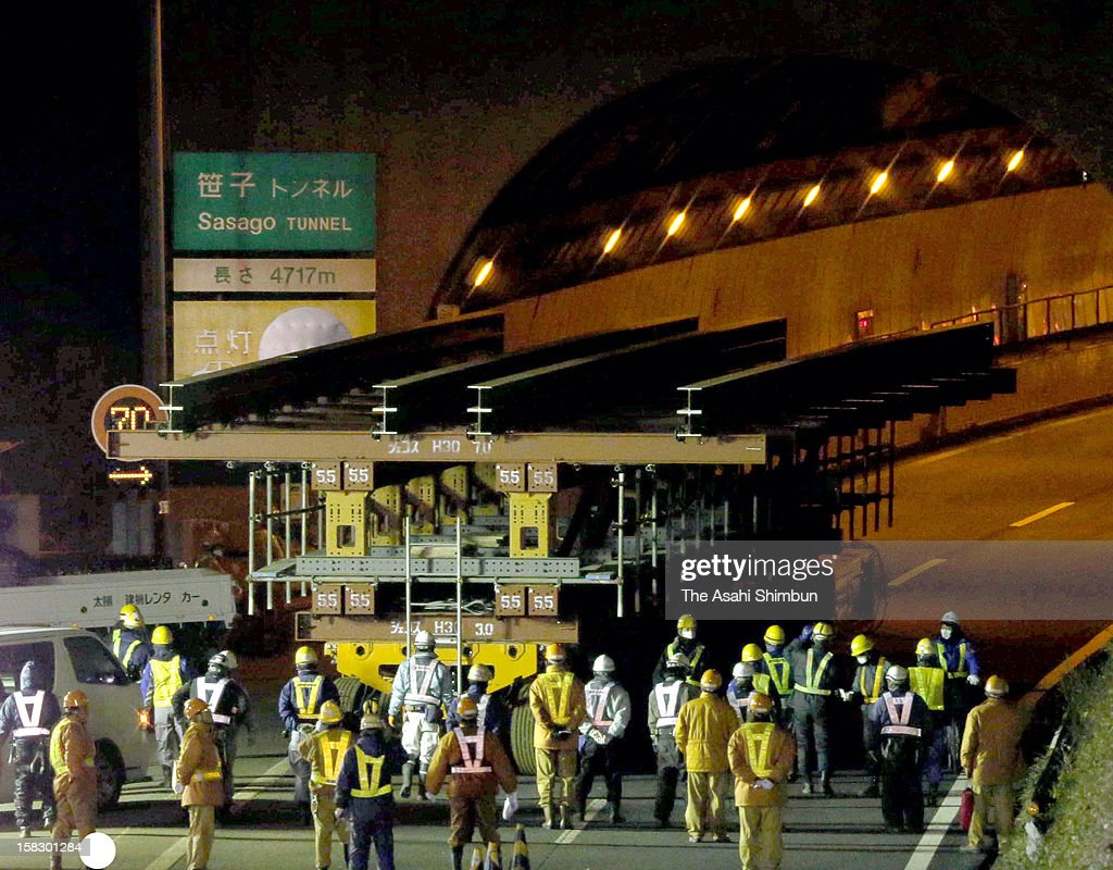 Gigantic self-propelled dolly enters Sasago tunnel as Chuo Expressway begins removal of collapsed ceiling after the accident that left nine dead on December 12, 2012 in Otsuki, Yamanashi, Japan.