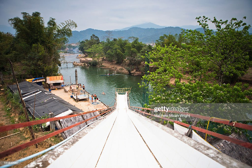 A gigantic slide alongside the river. : Stock Photo