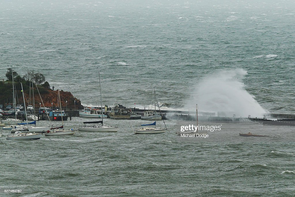Gigantic waves crash over trawling vessels at Mornington Harbour on May 3, 2016 in Melbourne, Australia. Wind gusts of up to 100km per hour are expected in Melbourne and parts of southern Victoria as part of a deep cold front moves across the state.