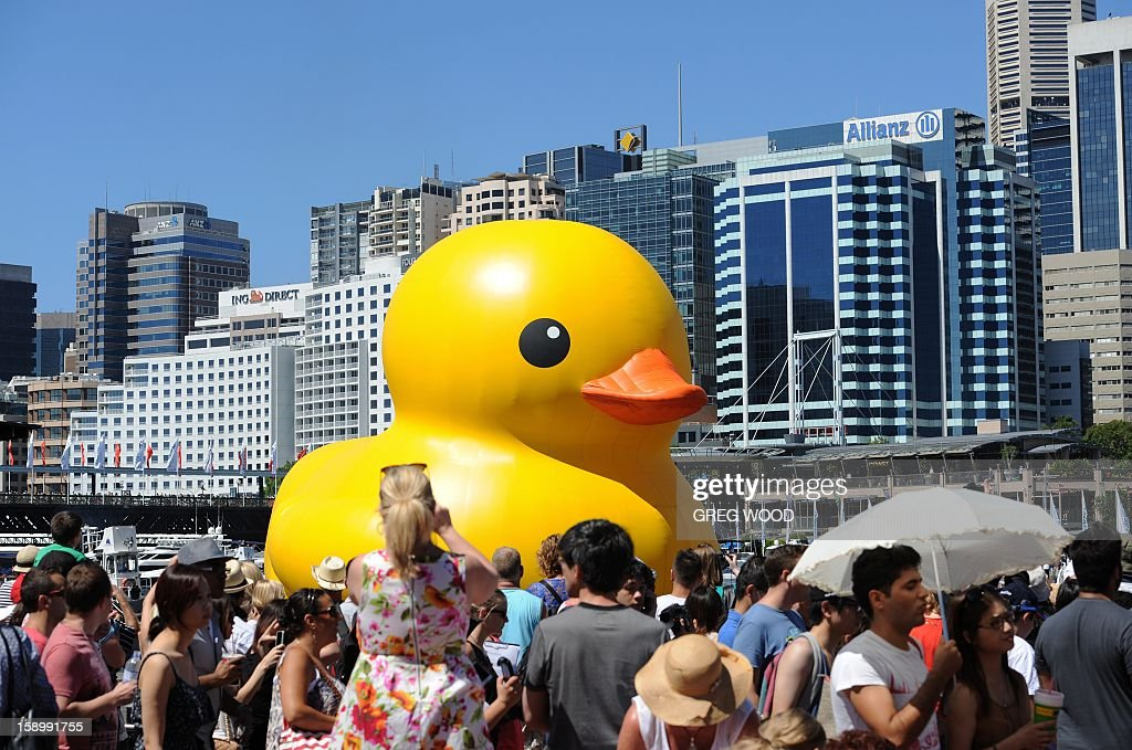 A gigantic, yellow rubber duck is floated into Sydney's Darling Harbour on January 5, 2013 to kick off Sydney's annual arts festival, a celebration which combines high-art with popular entertainment. The rubber duck by Dutch artist Florentijn Hofman forms part of the 2013 Sydney Festival which will present more than 750 artists from about 17 countries around the world, with many of the events free and family-oriented to showcase the personality of Australia's biggest city. AFP PHOTO / Greg WOOD