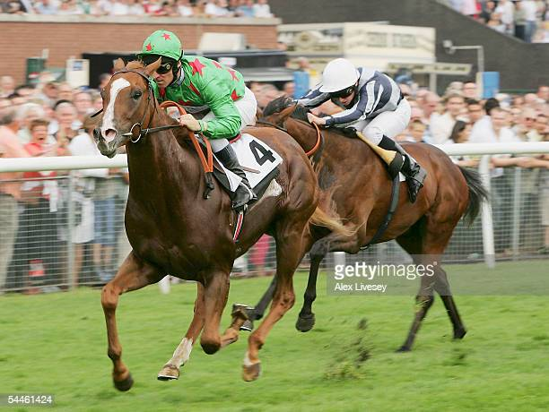 Giganticus ridden by Michael Hills wins The williamhillcasinocom EBF Maiden Stakes at Haydock Racecourse on September 3 2005 in Haydock England