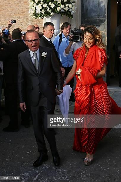 Gigi D'Alessio and Anna Tatangelo attend the Valeria Marini And Giovanni Cottone wedding at Ara Coeli on May 5 2013 in Rome Italy