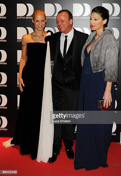 Gigi D'Alessio Anna Tatangelo and Michelle Hunziker attend 'Doppia Difesa' charity gala event on November 26 2009 in Milan Italy