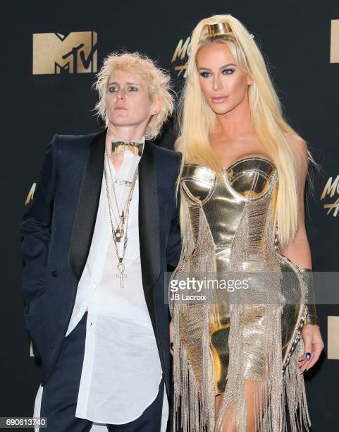 Gigi Gorgeous and Nats Getty attend the 2017 MTV Movie and TV Awards at The Shrine Auditorium on May 7 2017 in Los Angeles California