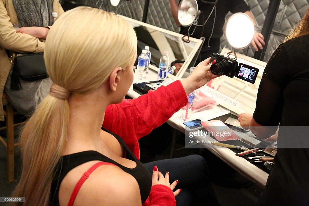 <a gi-track='captionPersonalityLinkClicked' href=/galleries/search?phrase=Gigi+Gorgeous&family=editorial&specificpeople=12850634 ng-click='$event.stopPropagation()'>Gigi Gorgeous</a> prepares backstage at The American Heart Association's Go Red For Women Red Dress Collection 2016 Presented By Macy's at The Arc, Skylight at Moynihan Station on February 11, 2016 in New York City.