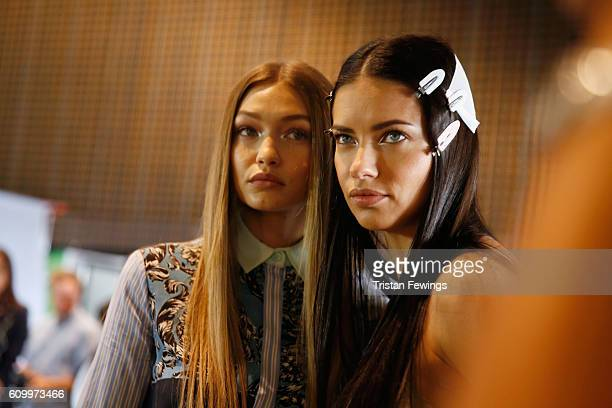 Gigi Hadid and Adriana Lima seen backstage ahead of the Versace show during Milan Fashion Week Spring/Summer 2017 on September 23 2016 in Milan Italy