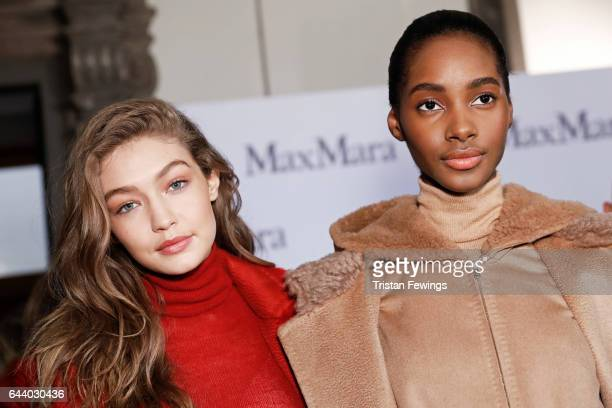 Gigi Hadid and Amilna Estevao are seen backstage ahead of the Max Mara show during Milan Fashion Week Fall/Winter 2017/18 on February 23 2017 in...