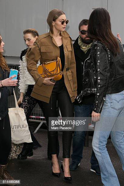 Gigi Hadid and Bella Hadid are seen leaving the 'Miu Miu' fashion show on March 9 2016 in Paris France
