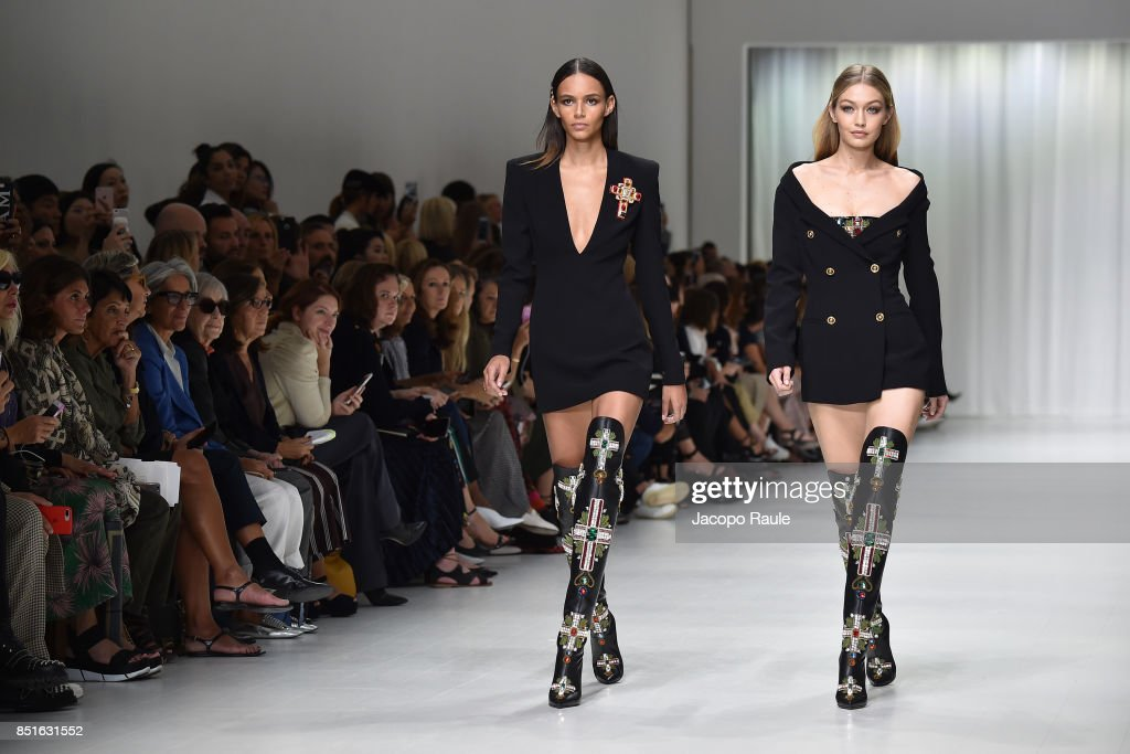 Gigi Hadid and Binx Walton walk the runway at the Versace show during Milan Fashion Week Spring/Summer 2018 on September 22, 2017 in Milan, Italy.