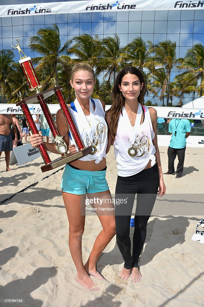 <a gi-track='captionPersonalityLinkClicked' href=/galleries/search?phrase=Gigi+Hadid&family=editorial&specificpeople=9198520 ng-click='$event.stopPropagation()'>Gigi Hadid</a> and <a gi-track='captionPersonalityLinkClicked' href=/galleries/search?phrase=Lily+Aldridge&family=editorial&specificpeople=2110490 ng-click='$event.stopPropagation()'>Lily Aldridge</a> attend Sports Illustrated Swimsuit Beach Volleyball Tournament on Ocean Drive at Miami Beach on February 20, 2014 in Miami, Florida.