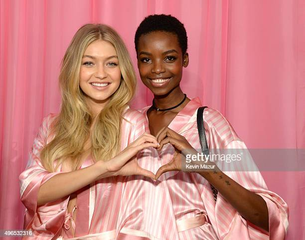 Gigi Hadid and Maria Borges get ready backstage before the 2015 Victoria's Secret Fashion Show at Lexington Armory on November 10 2015 in New York...