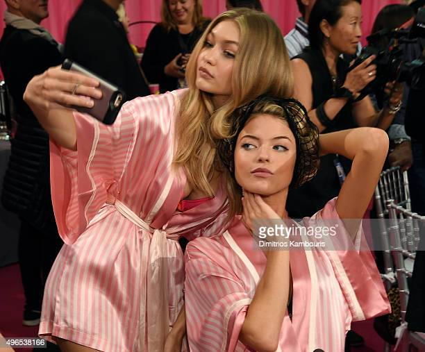 Gigi Hadid and Martha Hunt are seen backstage before the 2015 Victoria's Secret Fashion Show at Lexington Avenue Armory on November 10 2015 in New...