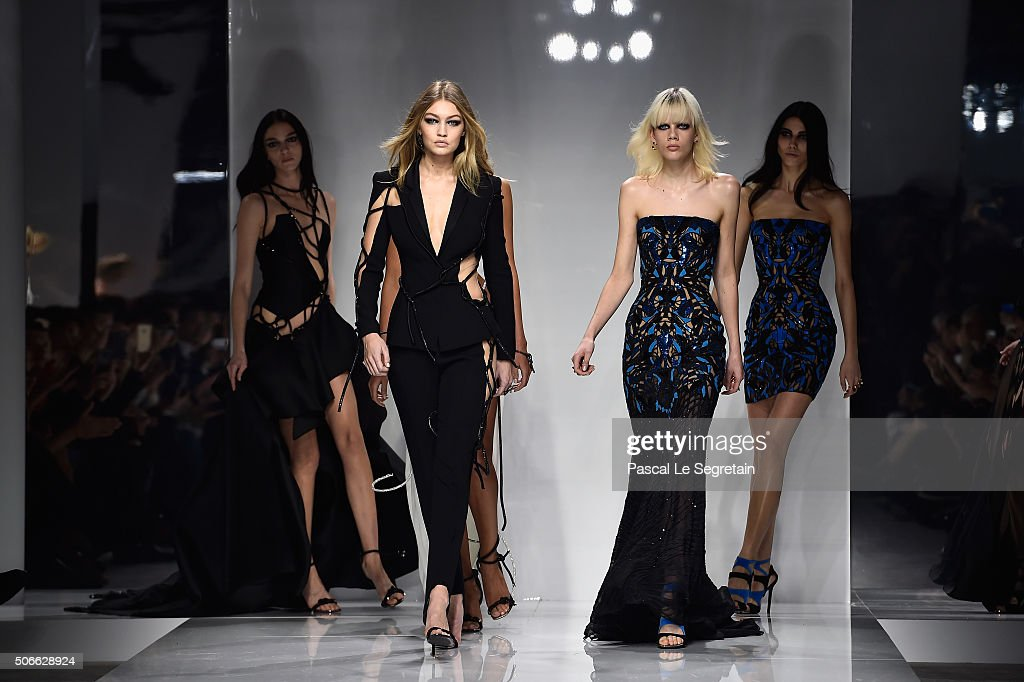 Gigi Hadid and models walk the runway during the Versace Spring Summer 2016 show as part of Paris Fashion Week on January 24 2016 in Paris France