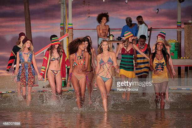 Gigi Hadid and Models walk through water at Tommy Hilfiger Women's Spring 2016 during New York Fashion Week The Shows at Pier 36 on September 14 2015...
