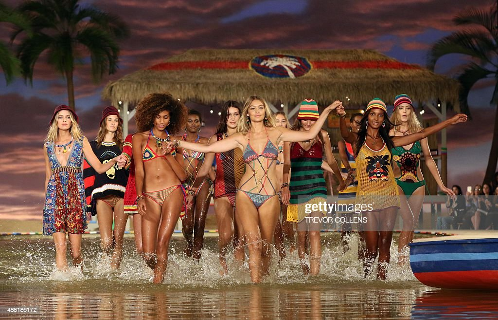 US Gigi Hadid and others models splash through a water feature on the set during the Tommy Hilfiger presentation during New York Fashion Week in New...